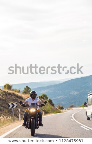 young brutal man driving a motorcycle stock photo © deandrobot
