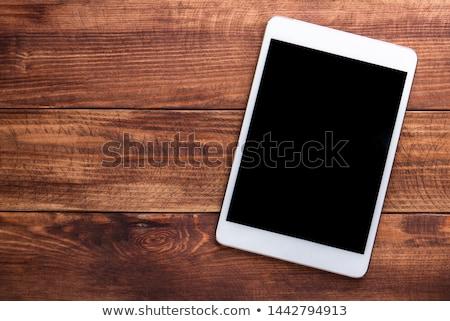 Online on wooden table Stock photo © fuzzbones0