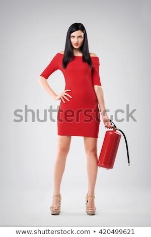 Genç güzel bir kadın yangın söndürücü kadın kız gülümseme Stok fotoğraf © konradbak