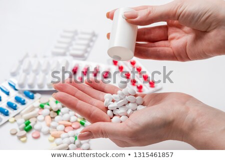 Stock fotó: Female Doctor Hand Full Of Various Pills And Medications