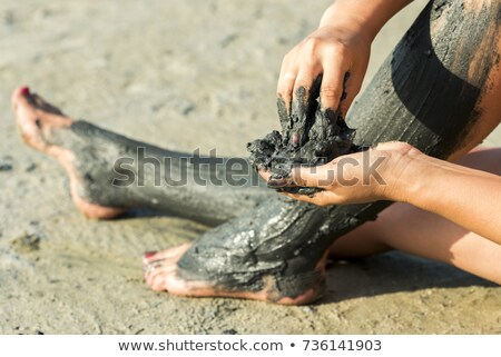 The curative mud on the skin of a beautiful young girl Stock photo © Yatsenko