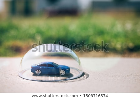 ストックフォト: White Car Protected Under A Glass Dome