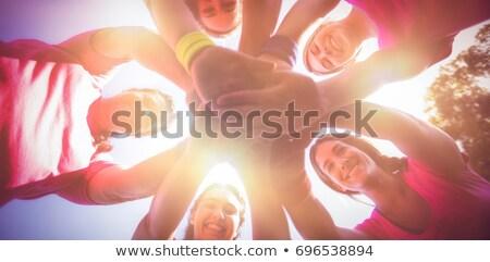 ストックフォト: グループ · 女性 · 手 · スタック · ブート · キャンプ