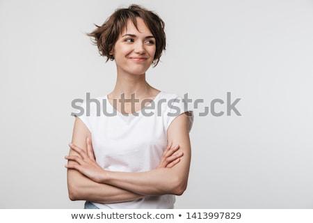 beautiful brunette woman standing indoors stock photo © deandrobot