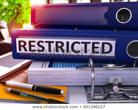 Niebieski biuro folderze napis ograniczony pulpit Zdjęcia stock © tashatuvango