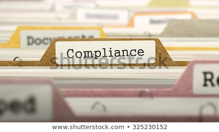 Stock photo: Folder in Catalog Marked as Compliance