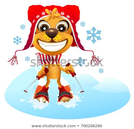 Yellow dog skier in red hat skiing Stock photo © orensila
