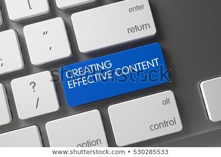 Keyboard with Blue Keypad - Creating Effective Content. Stock photo © tashatuvango