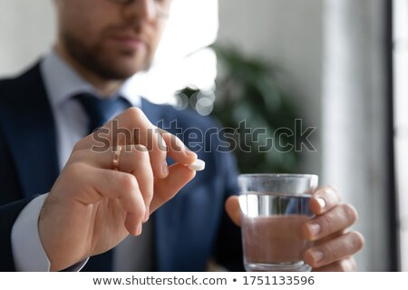 stressed man at workplace having diet problems stock photo © ichiosea