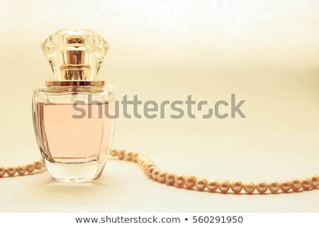 Perfume in a glass bottle and pearl beeds Stock photo © caimacanul