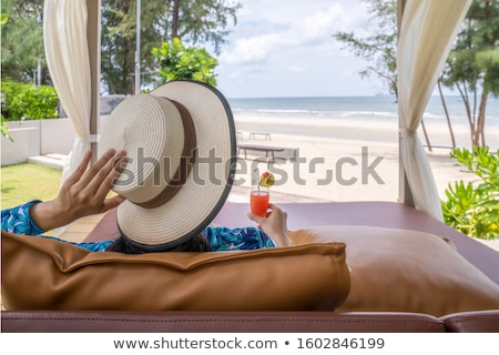 woman in beach pavilion enjoying her summer vacation i the sun stock photo © kzenon
