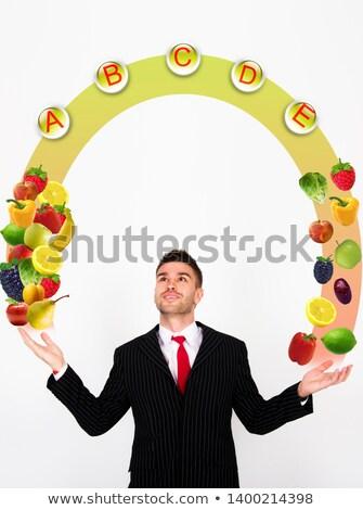 Kaukasisch jongen jongleren groenten vruchten hoofd Stockfoto © RAStudio