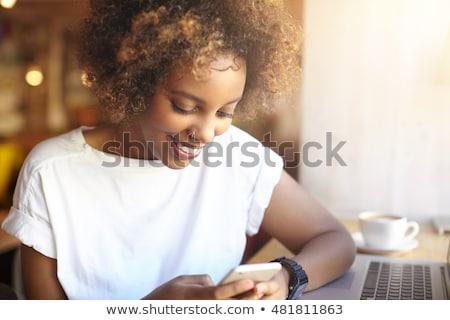 woman looking for restaurant in her smartphone stock photo © rastudio
