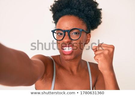 агрессивный женщину камеры сердиться подчеркнуть Сток-фото © stokkete