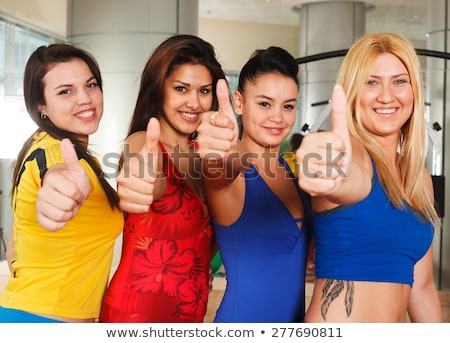 Smiling multi-ethnic friends showing thumbs up in gym Stock photo © wavebreak_media