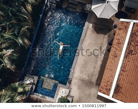 young woman lying by the pool stock photo © boggy