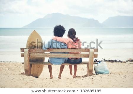 Pár ül szörfdeszkák égbolt víz tenger Stock fotó © IS2