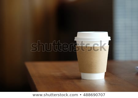 Disposable coffee cup on table in cafe Stock photo © wavebreak_media