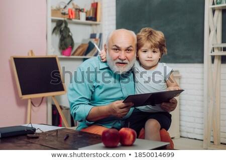 Tanár könyv iskolatábla osztályterem fiatal ázsiai Stock fotó © vectorikart