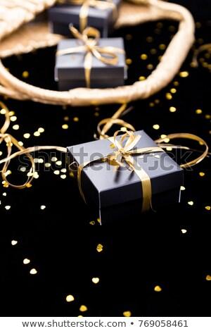 Noir coffrets cadeaux or ruban pop sur Photo stock © Illia