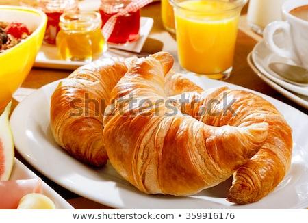 Delicious croissant with juice Stock photo © dash