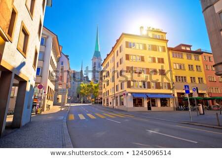 Zurich fountain and street view with sun haze stock photo © xbrchx