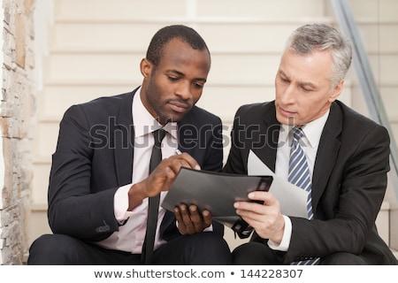 Senior pessoas de negócios falante ao ar livre discutir maduro Foto stock © boggy