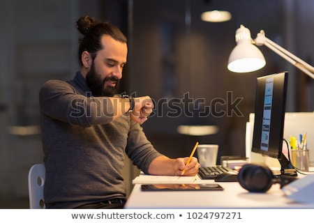 man with smartwatch using voice recorder at office Stock photo © dolgachov