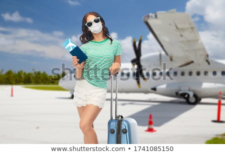 teenage girl with travel bag over airfield Stock photo © dolgachov