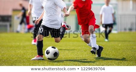 twee · jonge · jongens · voetbal · sportkleding · lopen - stockfoto © matimix