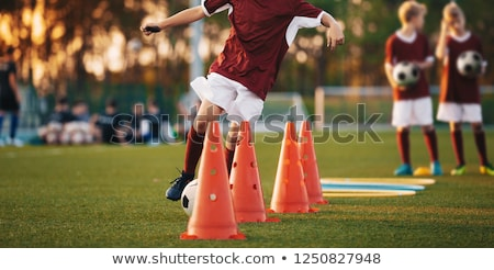 Stock photo: Football Drills: The Slalom Drill. Youth soccer practice drills. Young football players training