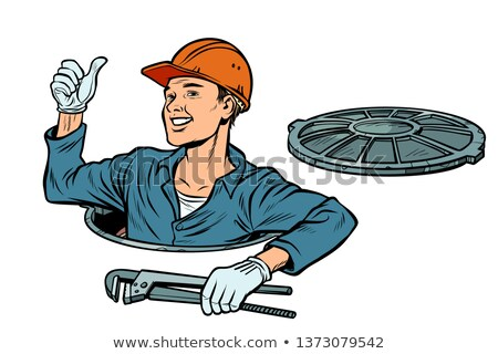Stock photo: gesture like. Plumber in the manhole