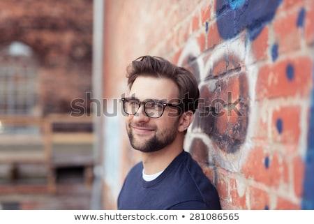Foto stock: Retrato · sorridente · jovem · barbudo · homem · óculos