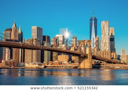 Manhattan Skyline моста снизить реке вечер Сток-фото © unkreatives