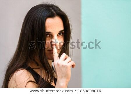 Donna naso dito imbarazzo femminile Foto d'archivio © artfotodima
