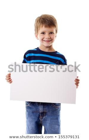 Little boy holding white board Stock photo © colematt
