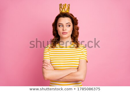 Pretty woman with wavy hair wearing diadem. stock photo © studiolucky