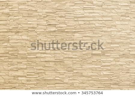 Vecchio giallo muro di pietra texture primo piano abstract Foto d'archivio © boggy
