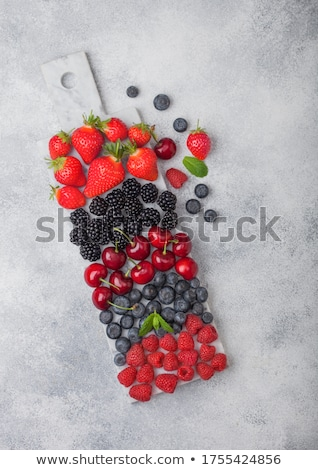 fresh organic summer berries mix on white marble board on marble stock photo © denismart