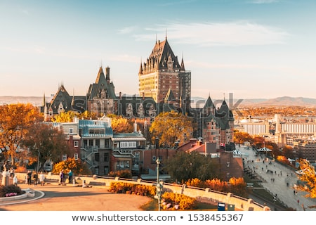 View of Chateau Frontenac by old town with golden autumn trees Stock photo © Lopolo