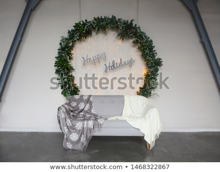 big christmas wreath by the wall with sign happy holidays stock photo © dashapetrenko