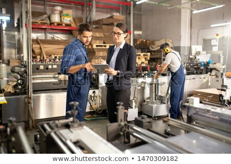 two young confident workers of processing factory discussing online data stock photo © pressmaster
