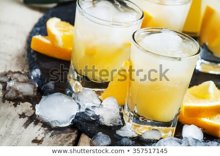 An orange soft drink  in a pitcher Stock photo © Zerbor