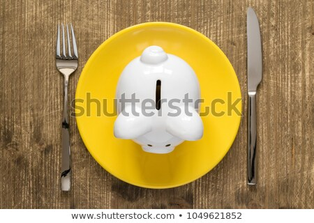 Piggy Bank On The Plate With Fork And Knife Stock photo © AndreyPopov