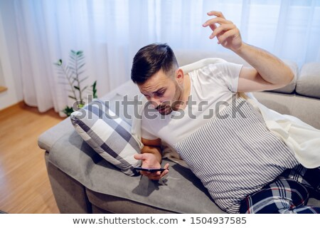 Man Getting Disturbed By Phone Calls Stock photo © AndreyPopov