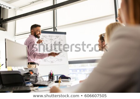 man drawing scheme for creative team at office Stock photo © dolgachov