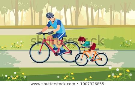 Сток-фото: счастливая · семья · верховая · езда · велосипедах · улице · улыбаясь · отец