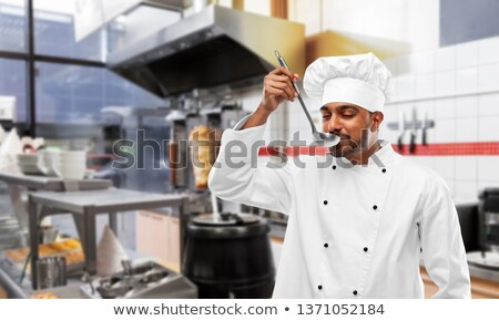 Indiai szakács kóstolás étel merőkanál kebab Stock fotó © dolgachov