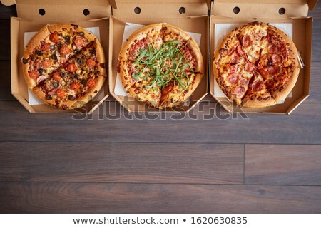 Three different kind of pizzas in delivery boxes Stock photo © dash
