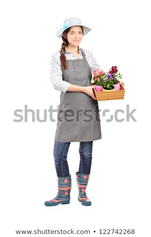 Young pretty gardener woman posing at stand with potted flowers Stock photo © dash